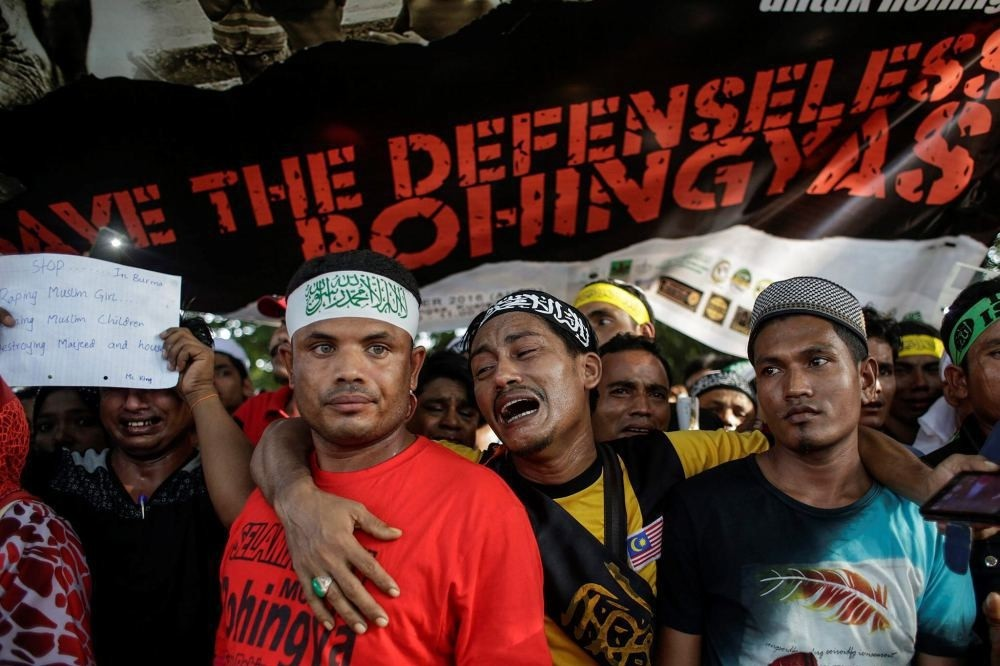 Rohingya Muslims react during a protest condemning Myanmaru2019s government violence on Rohingya people in Rakhine State, in Kuala Lumpur, Malaysia, Dec. 4.