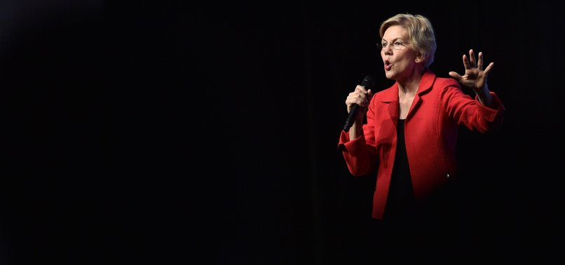 DEMOCRAT WARREN VOWS TO USE EVERY TOOL TO COMBAT WHITE NATIONALIST VIOLENCE