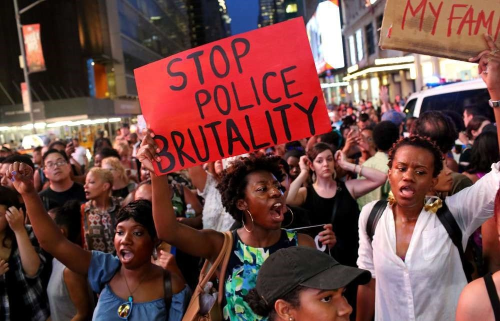 Activists protest in Times Square in New York City in response to the recent fatal shootings of two black men by police.