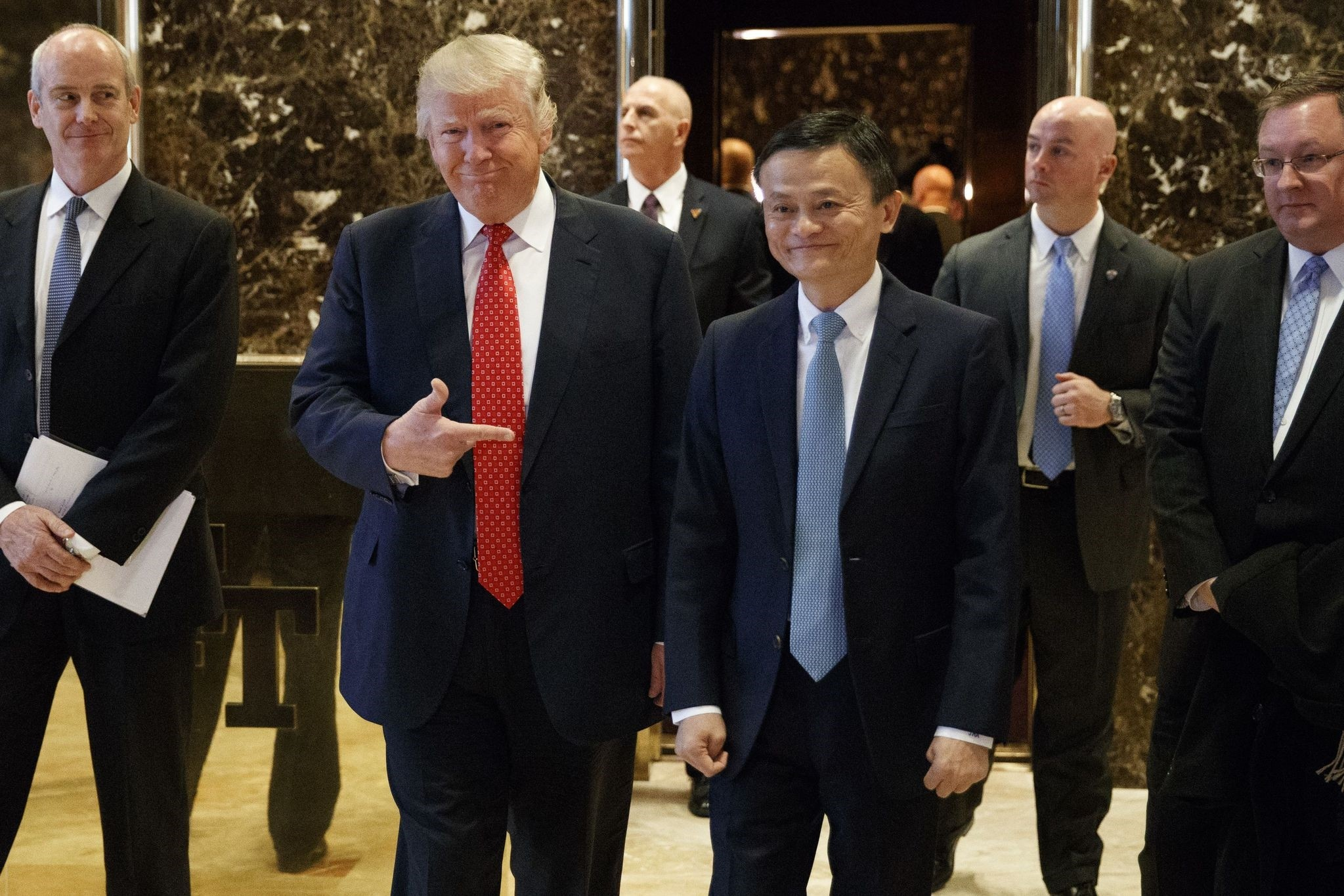 Jack Ma (R), founder and executive chairman of Alibaba Group, and President-elect Donald Trump speak to the media after their meeting at Trump Tower in New York.