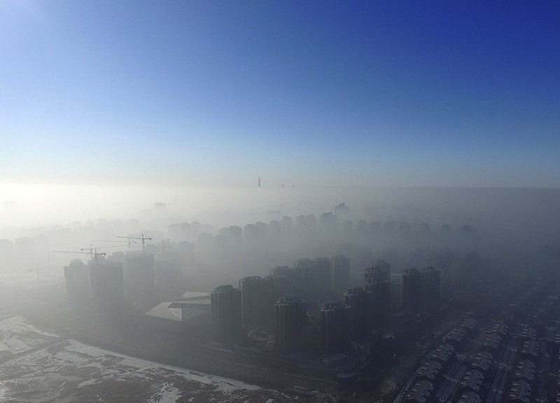 Smog is seen over the city against sky during a haze day in Tianjin, China, Jan. 2, 2017. (Reuters Photo)