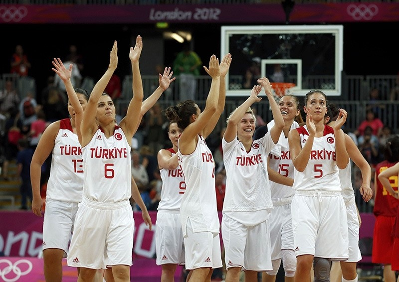 Players celebrate victory against China after their women's preliminary round Group A basketball match at the Basketball Arena during London 2012 Olympic Games (Reuters)