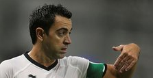 Spain great Xavi signs on for two more years in Qatar