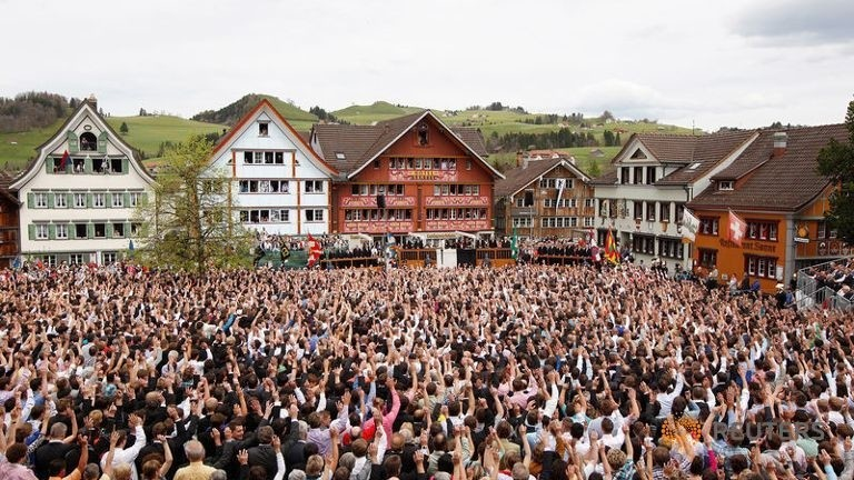 People raise their hands to vote during the annual Landsgemeinde meeting at a square in Appenzell, Switzerland, April 29, 2012 (Reuters Photo)