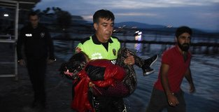 Turkish cop cries for migrant child fighting for life
