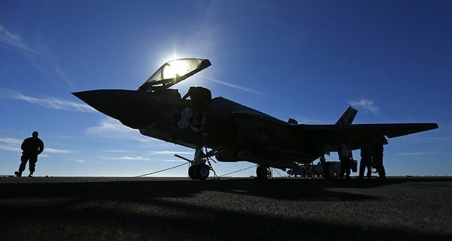 A Lockheed Martin Corp F-35C Joint Strike Fighter is shown on the deck of the USS Nimitz aircraft carrier after making the plane's first ever carrier landing using its tailhook system. (REUTERS Photo)