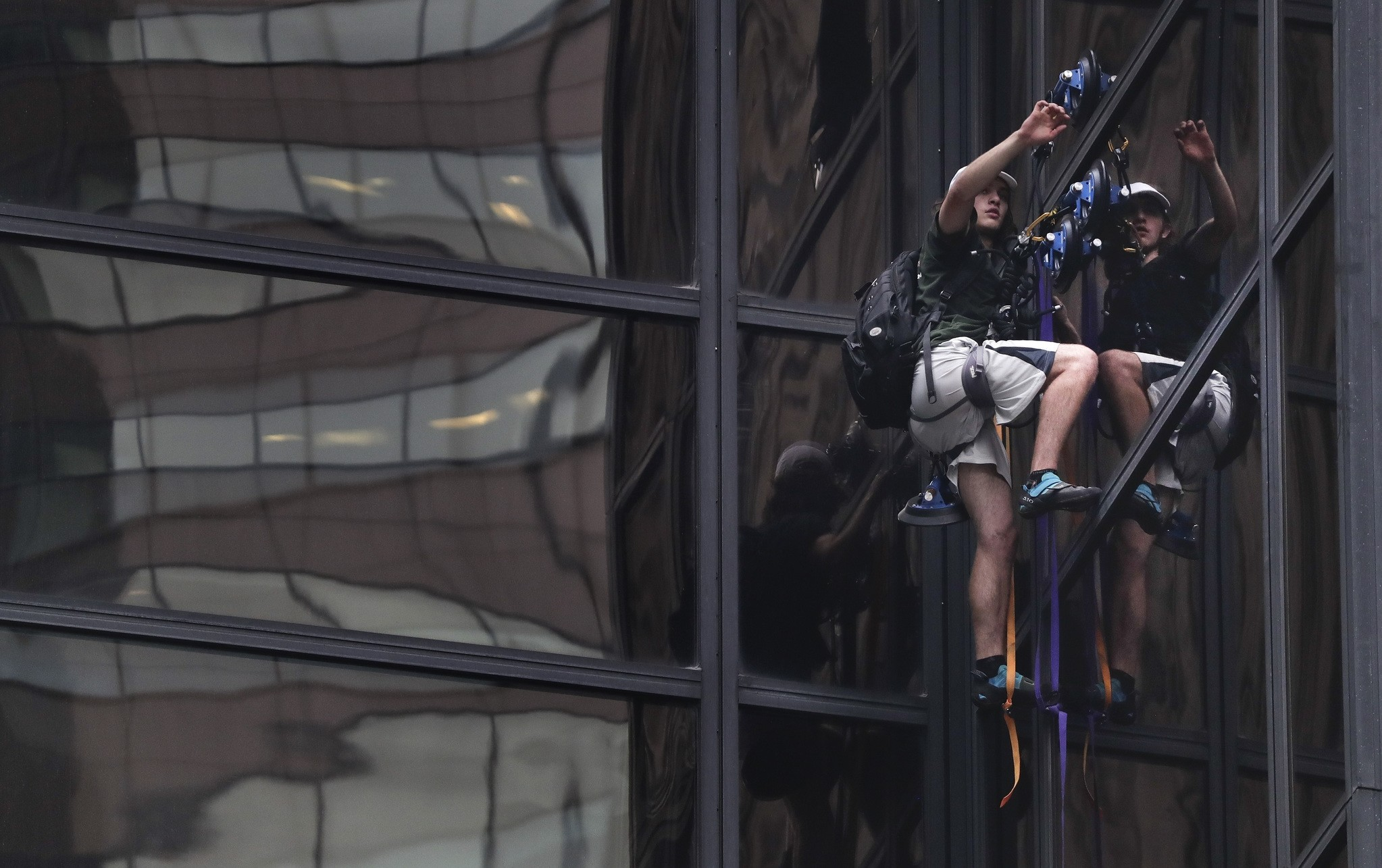 A man scales Trump Tower using suction cups, Wednesday, Aug. 10, 2016, in New York. (AP Photo)