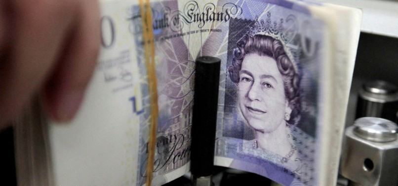 POUND NEARS 2-YEAR LOW AS ECONOMIC DOWNTURN LOOMS