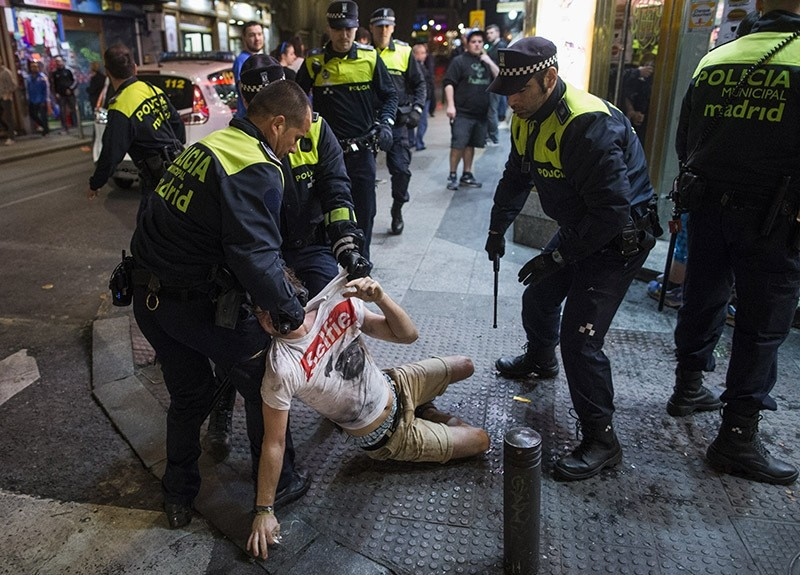 Spanish police arrest a troublemaker in Madrid, 2015 (AP Photo)