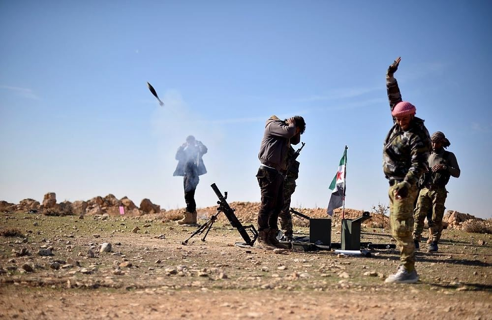 Free Syrian Army fighters during clashes against Daesh terrorists near the Syrian town of Qabasin on Nov. 21.