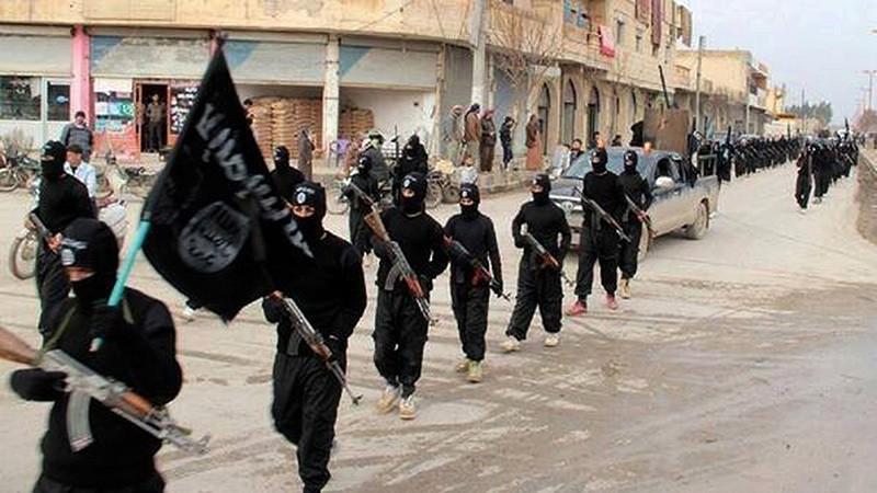 This undated file image posted on an extremist website on Jan. 14, 2014, shows fighters from the Daesh group marching in Raqqa, Syria. (AP Photo)
