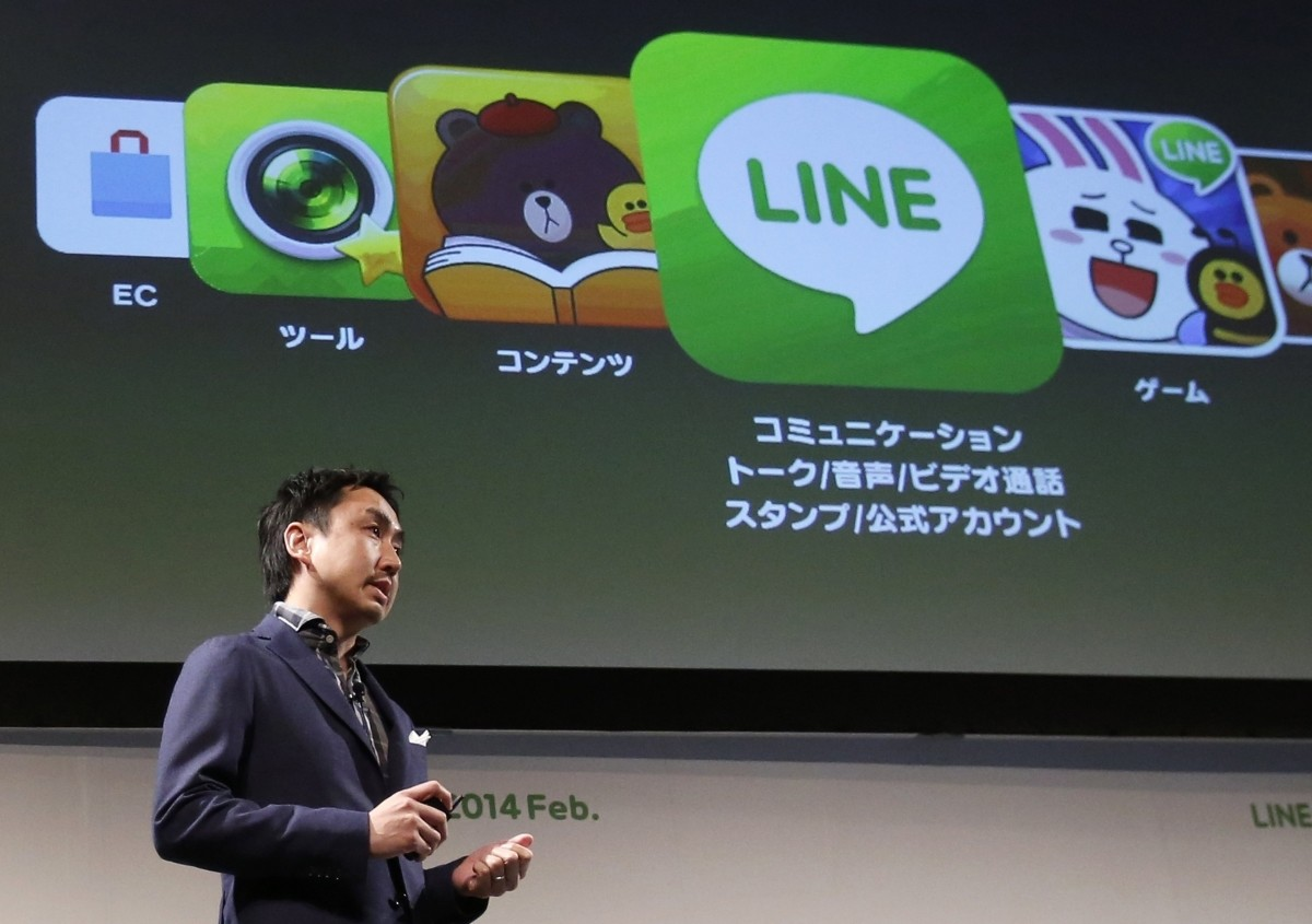 Takeshi Idezawa, chief executive officer of Line Corp, speaks during an announcement of its new service in Tokyo.