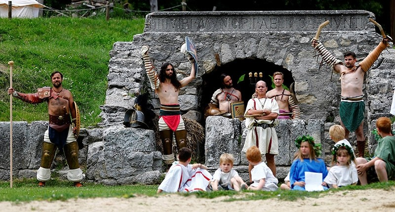 Members of the ,Familia Gladiatoria Carnuntina, arrive for a fight in the historic amphitheatre during the Roman Festival at the archeological site of Carnuntum in Petronell, Austria (Reuters Photo)