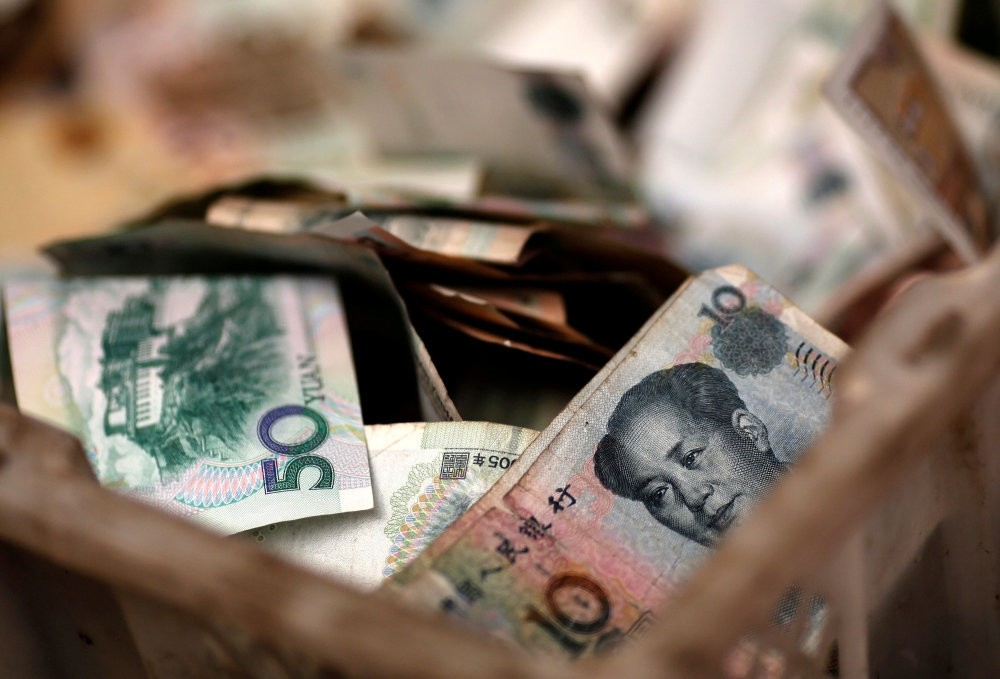 Chinese yuan banknotes are seen at a vendor's cash box at a market in Beijing. Turkey and China has realized the first currency swap transaction.