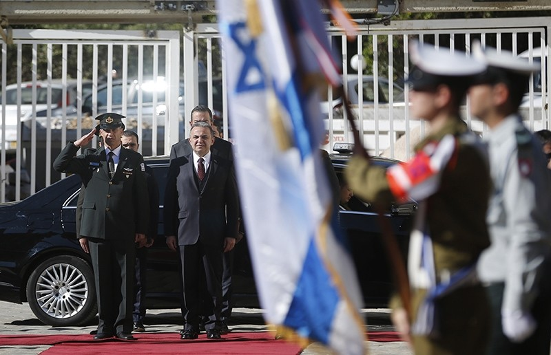 Turkish ambassador to Israel Kemal u00d6kem stands for the Turkish national anthem before presenting his diplomatic credentials to Israeli President (AFP Photo)