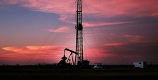 Oil prices down with rising US crude inventories