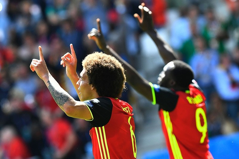 Belgium's midfielder Axel Witsel and Belgium's forward Romelu Lukaku (R) celebrate after scoring their team's second and third goals during the Euro 2016 group E football match (AFP Photo)