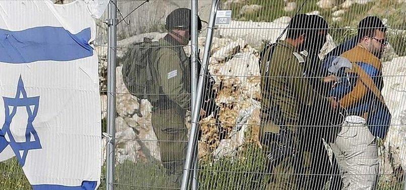 ISRAEL DETAINS 11 PALESTINIANS IN WEST BANK RAIDS