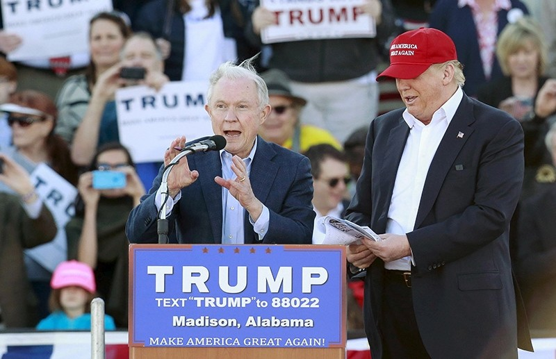 U.S. Senator Jeff Sessions speaks next to U.S. Republican presidential candidate Donald Trump at a rally at Madison City Schools Stadium in Madison (Reuters Photo)