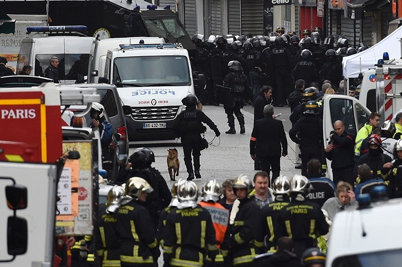 This file photo taken on November 18, 2015 shows Firefighters and policemen are gathering in the city center of the northern Paris suburb of Saint-Denis (AFP Photo)