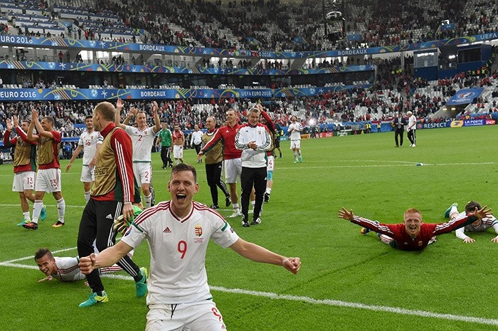 Hungary's forward Adam Szalai celebrate after a 2-0 victory in the Euro 2016 group F football match between Hungary and Austria at the Matmut Atlantique stadium in Bordeaux on June 14, 2016. (AFP Photo)