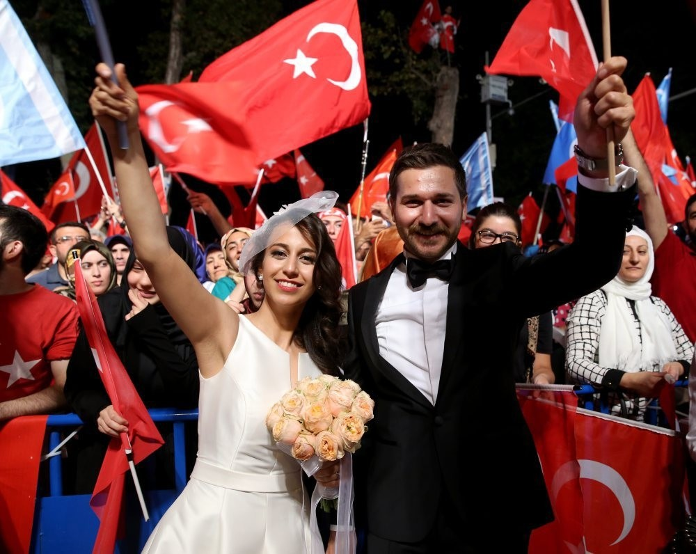 A newlywed couple at a u201cdemocracy watchu201d in Ku0131su0131klu0131, Istanbul.