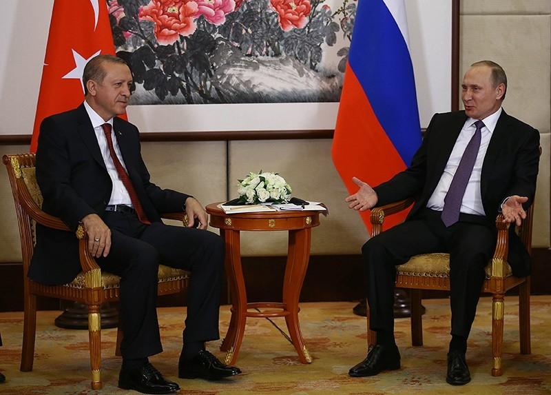 Russian President Vladimir Putin, right, and Turkish President Recep Tayyip Erdou011fan speak during their meeting ahead of the G20 Summit in Hangzhou, China, Saturday, Sept. 3, 2016. (Yasin Bu00fclbu00fcl, Presidential Press Service, Pool via AP)