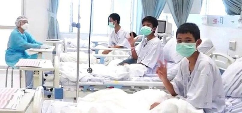 RESCUED THAI BOYS MAKE VICTORY SIGNS FROM HOSPITAL BEDS