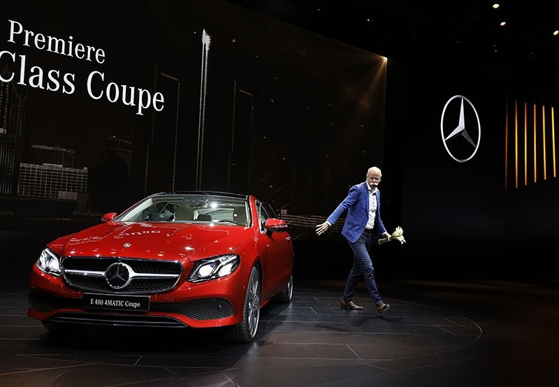 Dieter Zetsche, Head of Mercedes-Benz Cars, exits the new 2018 Mercedes-Benz E-Class Coupe during its reveal at the 2017 North American International Auto Show on January 9, 2017. (AFP Photo)