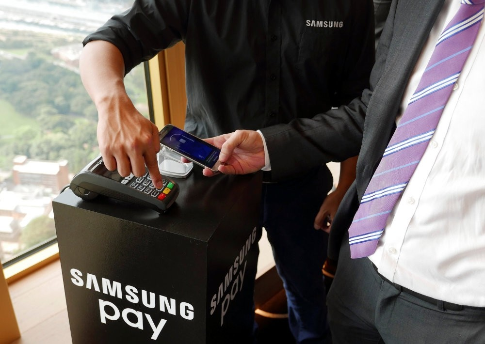 Samsung's new Samsung Pay mobile wallet system is demonstrated at its Australian launch in Sydney.