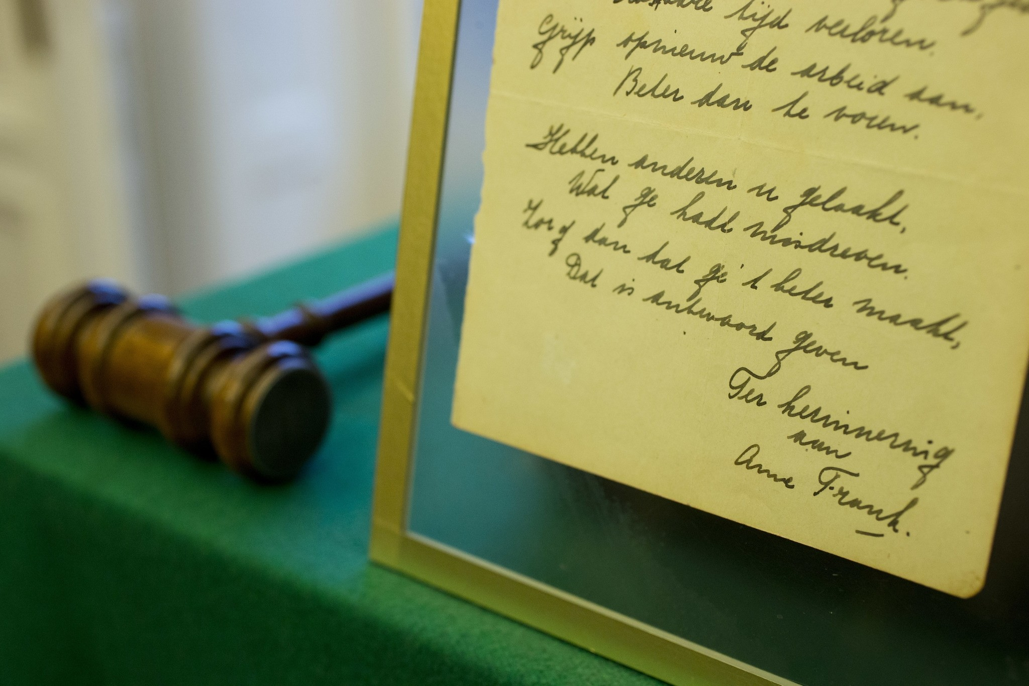 A short poem by Anne Frank, handwritten and dated in Amsterdam on March 28, 1942, is displayed at Bubb Kuyper auction house. (AP Photo)