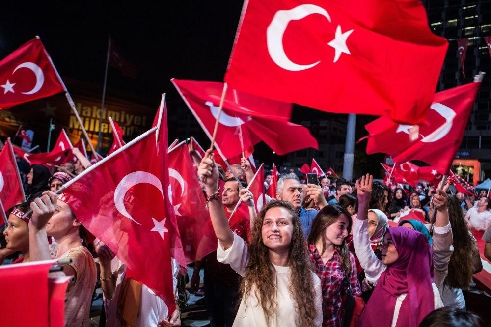 A woman waves a Turkish flag in a democracy watch in Taksim, Istanbul. (Photo by Murat u015eengu00fcl)