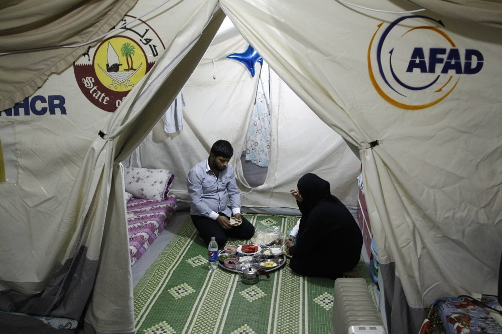 A Syrian family in a tent at the refugee camp in Kahramanmarau015f have u2018suhoor', a meal before the fast.