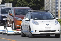 Nissan Motor Co. is testing self-driving cars at one of its plants in Japan that can tow vehicles on a trailer to the wharf for loading on transport ships.