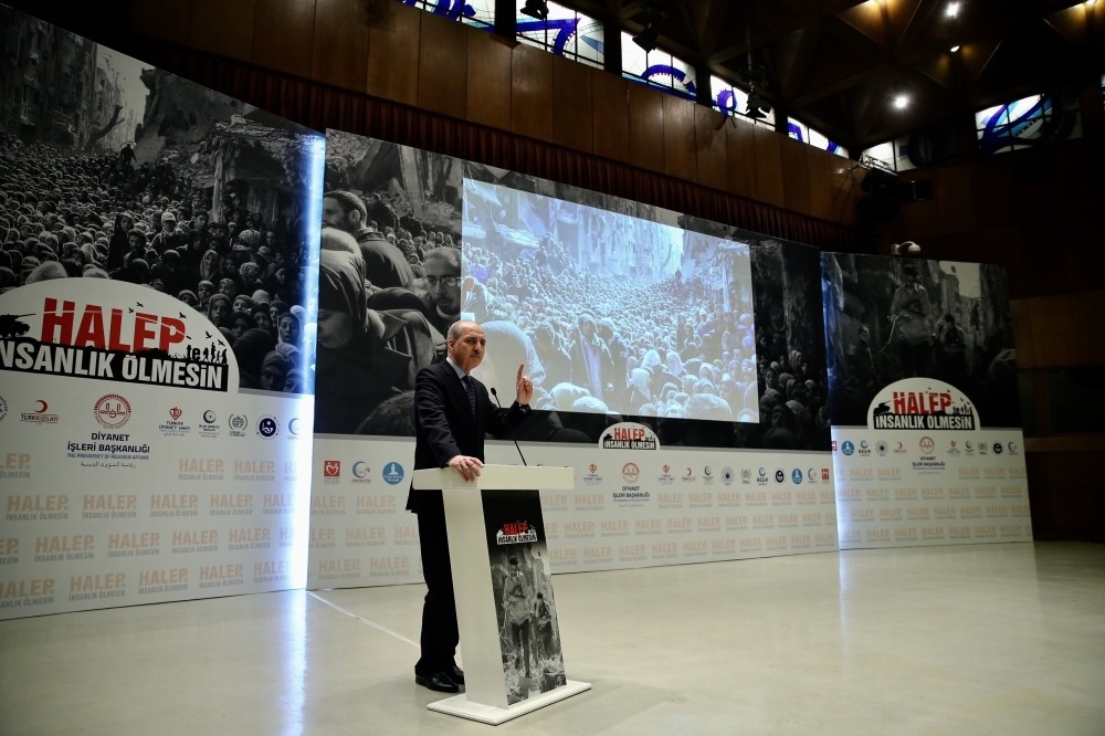 Deputy Prime Minister Numan Kurtulmuu015f speaks at the event to launch the campaign, against a backdrop of photos of Aleppo residents.