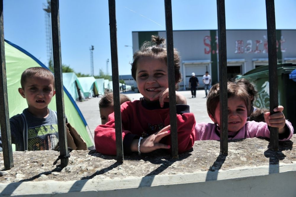 Children inside a new refugee camp in an abandoned factory in Sindos, a west suburb of Thessaloniki, May 27.