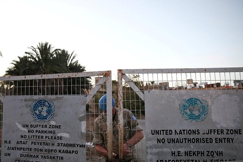 A U.N. soldier locks a gate inside the UN-controlled buffer zone in Nicosia, Cyprus, November 7, 2016. (Reuters Photo)