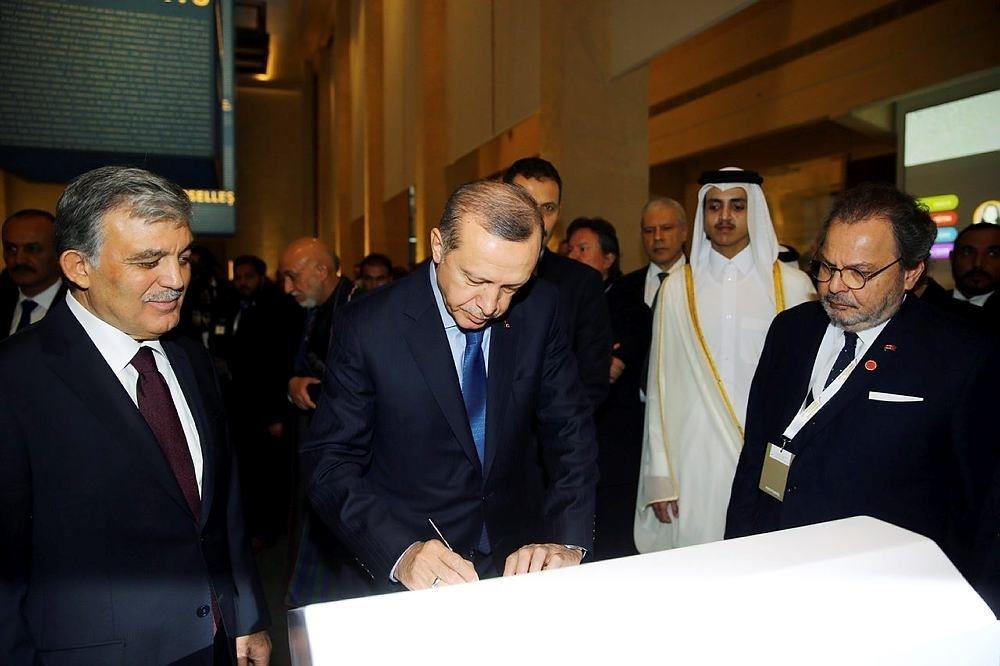 Former President Abdullah Gu00fcl (L) and President Erdou011fan (C)