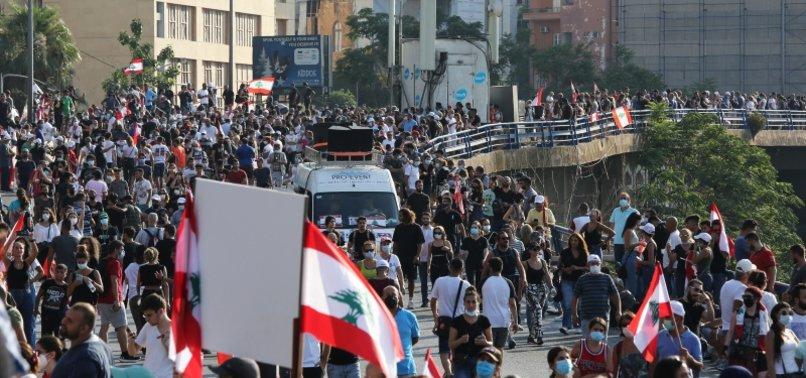 DOZENS HURT IN LEBANON CLASHES ON BLAST ANNIVERSARY