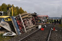 At least one person has died and six people have been injured following the collision of a train and a truck in southern Germany, police said on Friday.