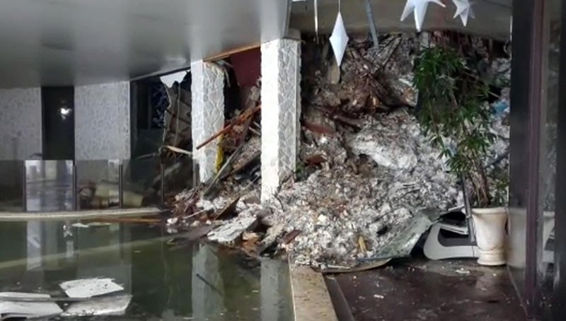This photo taken from a video shows show piles of snow and rubble cascading down the stairway into the foyer of the hotel Rigopiano in Farindola, Italy, early Thursday, Jan. 19, 2017. (AP Photo)