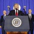 U.S. President Donald Trump, accompanied by Vice President Mike Pence, left, and Homeland Security Secretary John F. Kelly, pauses while speaking at the Homeland Security Department in Washington, Wednesday, Jan. 25, 2017. (AP Photo)