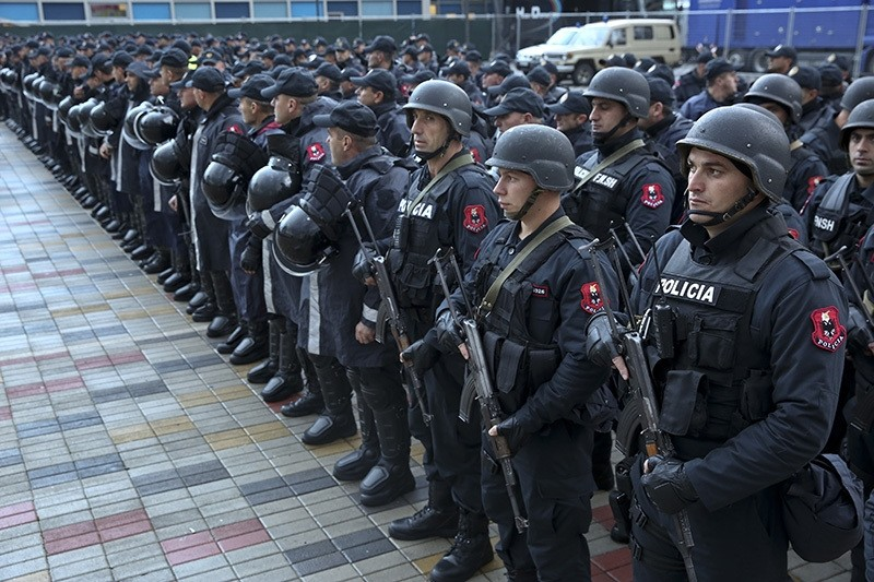 In this Saturday, Nov. 12, 2016 file photo, Albanian police forces line up in front of Elbasan Arena stadium where Albania will play their World Cup 2018 qualifying soccer match against Israel under tight security measures. (AP Photo)