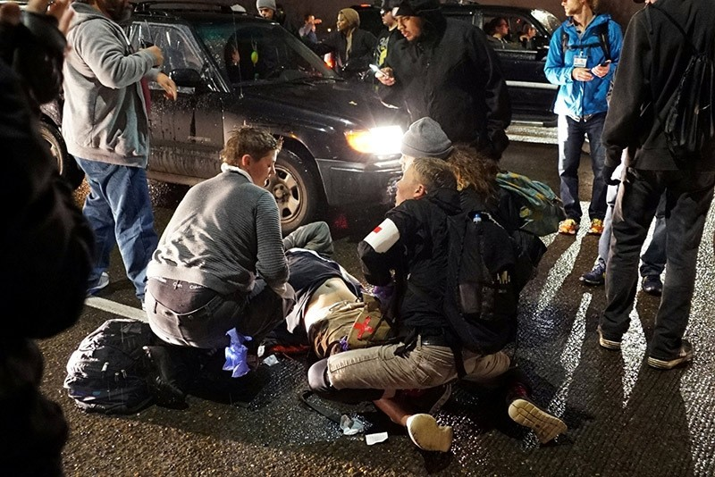 A demonstrator is treated for a gunshot wound during a protest against the election of Republican Donald Trump as President of the U.S. in Portland. (Reuters Photo)