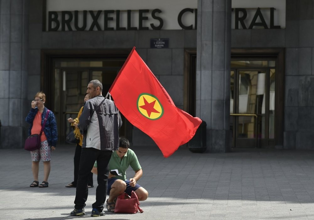 A  PKK supporter holds a PKK flag as he attends the terrorist organizations's demonstration in Brussels on Aug. 8, 2015.