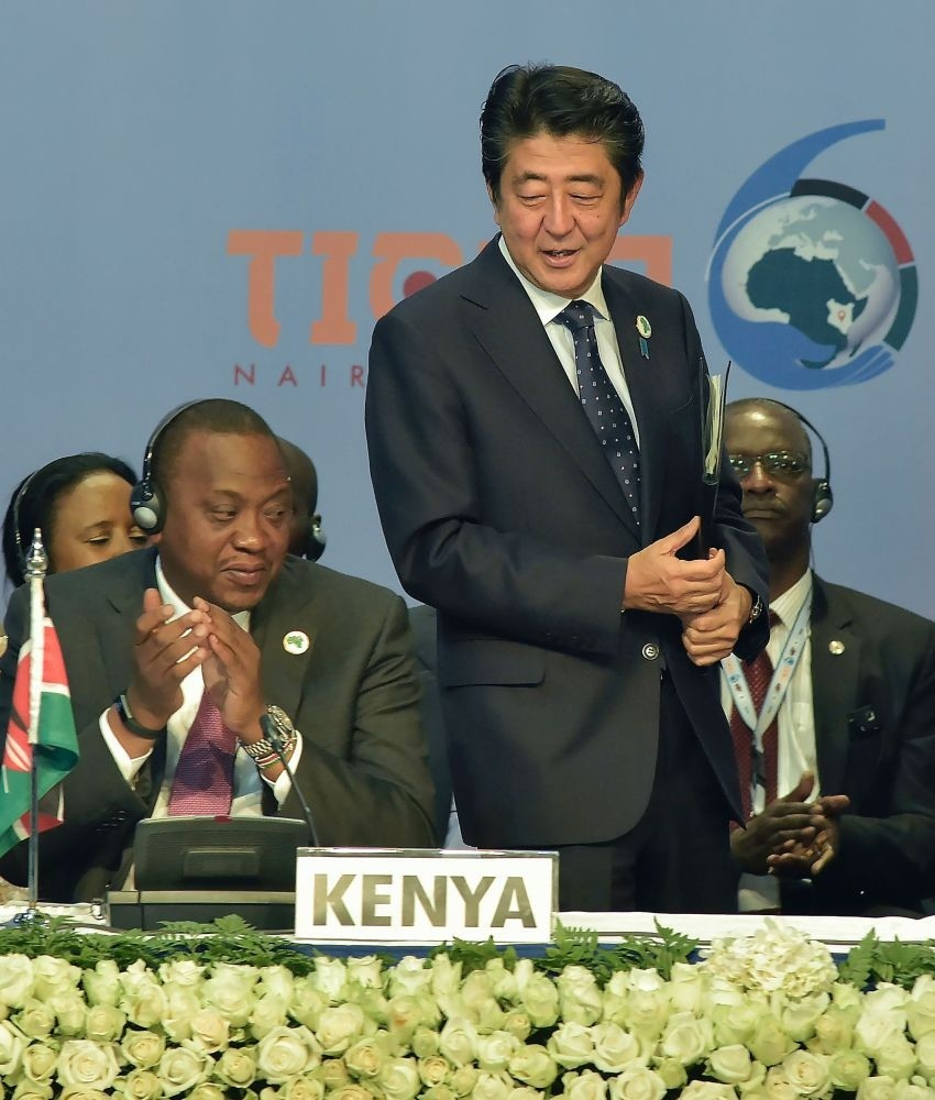 Japanese Prime Minister Shinzo Abe (R) stands next to Kenyau2019s President Uhuru Kenyatta (L) during the opening of the Tokyo International Conference on African Development in Nairobi.