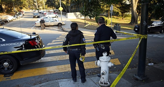 San Francisco Police stand at the site of a shooting outside the June Jordan School for Equity and City Arts and Technology High School, which share a campus, San Francisco, Calif., Oct. 18, 2016. (AP Photo)