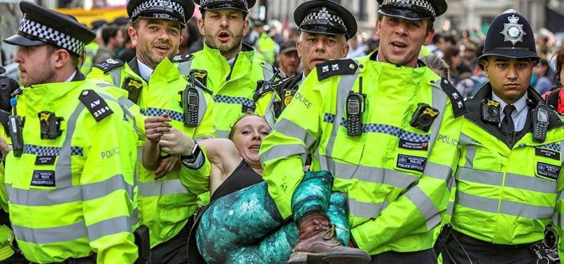 POLICE ARREST OVER 460 IN LONDON CLIMATE PROTEST