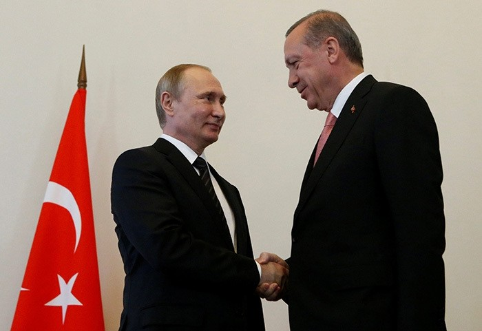 Russian President Vladimir Putin shakes hands with Turkish President Tayyip Erdogan during their meeting in St. Petersburg, Russia, August 9, 2016. (Reuters Photo)