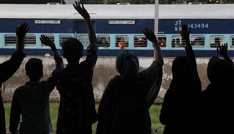 People see off passengers traveling to neighboring India at a railway station in Lahore, Pakistan, Monday, Sept. 26, 2016 (AP Photo)